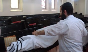 Rabbi Levi Jaffe taking a Torah scroll from the Brisbane Hebrew Congregation to move to his home in the wake of flooding in Australia, Jan. 12, 2011. (Rabbi Levi Jaffe)
