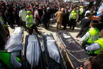 The bodies of the victims of Monday's shooting at a Jewish school in Toulouse, France, during their joint funeral service in Jerusalem, March 21, 2012. (Uri Lenz/FLASH90 )