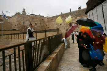 A haredi boy throws garbage at Jewish women as they come to pray at the Western Wall in a session organized each month by the Women of the Wall, Dec. 18, 2009. (Miriam Alster / Flash 90 / JTA)