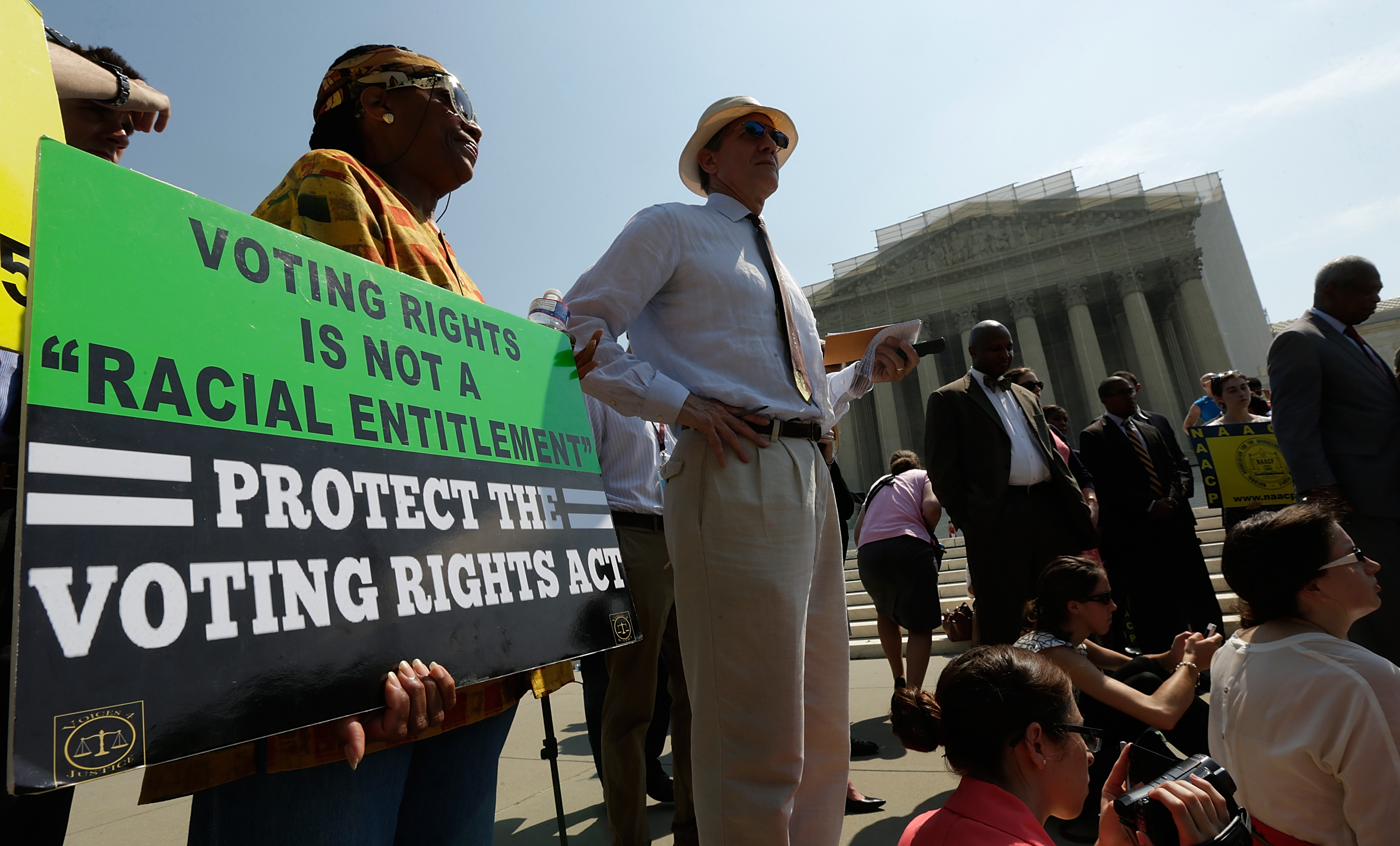Supporters of the Voting Rights Act waiting outside the U.S. Supreme Court building in Washington after the court struck down a section aimed at protecting minority voters